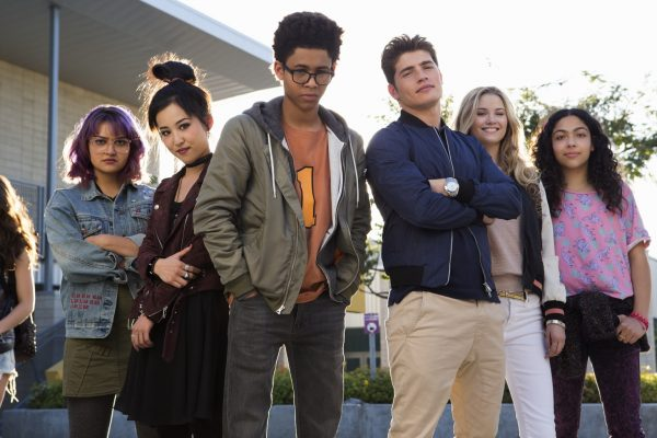"RUNAWAYS - ""Pilot"" - Episode 101 - Every teenager thinks their parents are evil. What if you found out they actually were?  Marvelユs Runaways is the story of six diverse teenagers who can barely stand each other but who must unite against a common foe ミ their parents. The 10-episode series premieres Tuesday, November 21st. The series stars Rhenzy Feliz, Lyrica Okano, Virginia Gardner, Ariela Barer, Gregg Sulkin, Allegra Acosta, Annie Wersching, Ryan Sands, Angel Parker, Ever Carradine, James Marsters, Kevin Weisman, Brigid Brannah, James Yaegashi, Brittany Ishibashi, and Kip Pardue. From left: Gert Yorkes (Ariela Barer), Nico Minoru (Lyrica Okano), Alex Wilder (Rhenzy Feliz), Chase Stein (Gregg Sulkin), Karolina Dean (Virginia Gardner) and Molly Hernandez (Allegra Acosta), shown. (Photo by: Paul Sarkis/Hulu)"